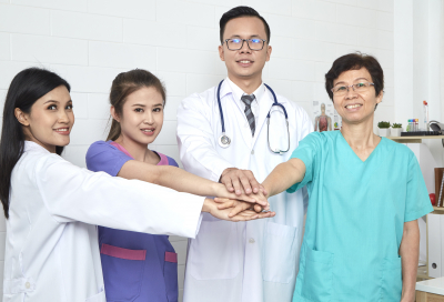 Asian doctor and nurse medical team in hospital